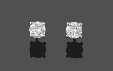 A Pair of Diamond Solitaire Earrings, round brilliant cut diamonds...