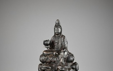 A SILVERED 'ROYAL EASE' BRONZE FIGURE OF GUANYIN,...