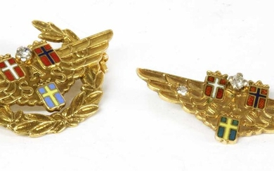 A Scandinavian Airlines gold diamond and enamel brooch