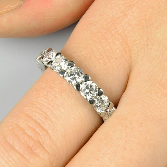 A brilliant-cut diamond tapered full eternity ring.