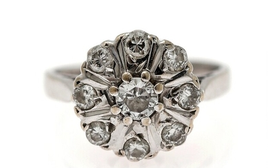 A diamond ring set with numerous old-cut diamonds, mounted in 18k white gold. Size app....