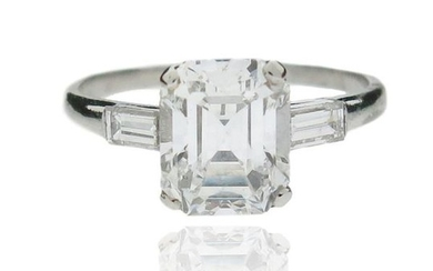 A diamond solitaire ring, set with an emerald-cut...
