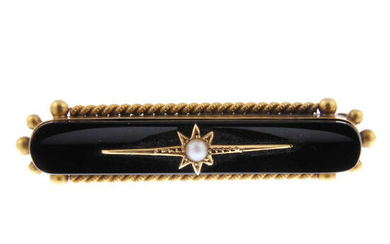 A late 19th century gold onyx and split pearl bar brooch.