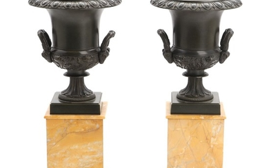 A pair of 19th century urn shaped patinated bronze brûle-parfumes on Siena marble base. H. 40 cm. (2)