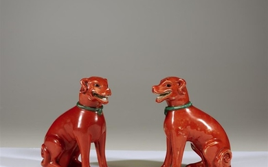 A pair of Chinese iron-red glazed porcelain figures of...