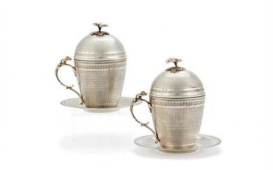 A pair of Ottoman silver parcel gilt sahlep cups, covers and stands
