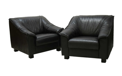 A pair of black leather armchairs