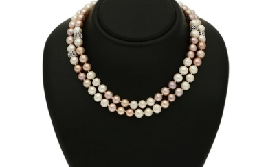 A pearl necklace set with numerous cultured freshwater pearls, four beads set with numerous brilliant-cut black diamonds, mounted in 18k white gold. L. 90 cm