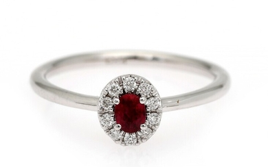 NOT SOLD. A ruby and diamond ring set with a ruby encircled by numerous diamonds,...