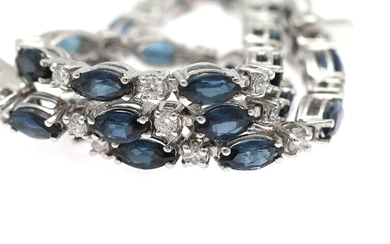 NOT SOLD. A sapphire and diamond bracelet set with numerous marquise-cut sapphires and numerous brilliant-cut...