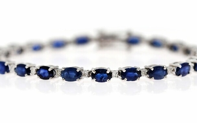 NOT SOLD. A sapphire and diamond bracelet set with numerous oval-cut sapphires weighing a total...