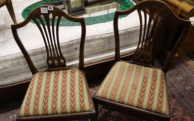 A set of four Hepplewhite style dining chairs (3 single, 1 a...
