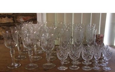 A suite of drinking glasses with etched leaf and flower deta...