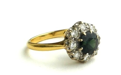 AN 18CT GOLD AND PLATINUM RING, SET WITH A CENTRAL SAPPHIRE ...