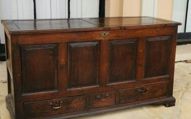AN 18TH CENTURY OAK MULE CHEST Having a panelled top and fro...