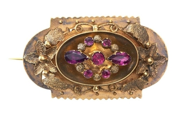 AN ANTIQUE GARNET BROOCH - Featuring a central garland of pink garnets, within a floral and foliate surround, with photo locket to v...