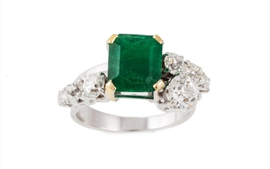 AN EMERALD AND DIAMOND DRESS RING, of cross over design, set...