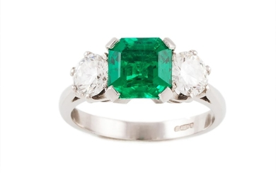 AN EMERALD AND DIAMOND THREE STONE RING, with one octagonal ...