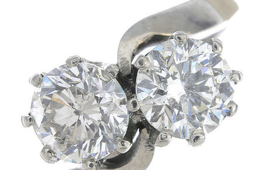 An 18ct gold brilliant-cut fracture-filled diamond two-stone crossover ring.