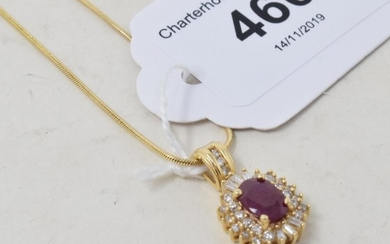 An 18ct gold, ruby and diamond pendant, on a chain