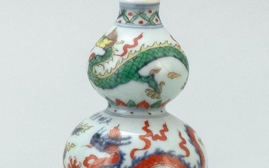 CHINESE DOUCAI PORCELAIN DOUBLE GOURD VASE Decorated with five-clawed dragons chasing fiery pearls. Blue six-character Xuande mark a...