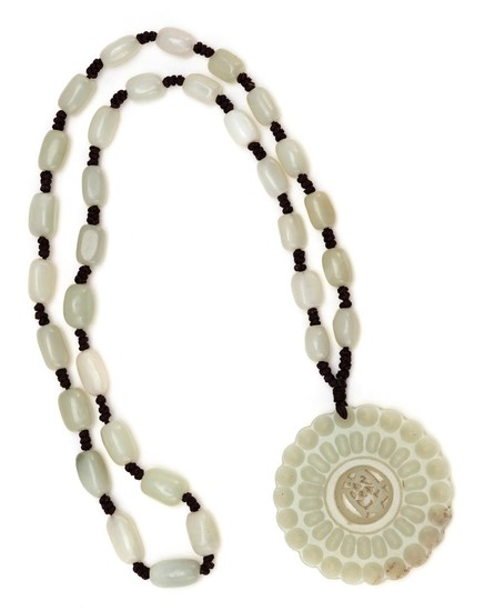 """CHINESE WHITE JADE BEAD NECKLACE WITH DISK PENDANT Floriform pendant with reticulated openwork central medallion, diameter 3"""", suspe..."""