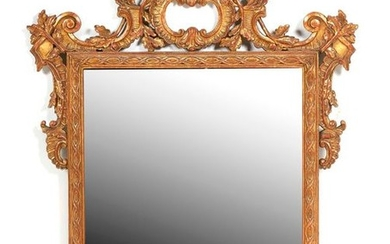 Carved and gilded wood mirror of rectangular shape...
