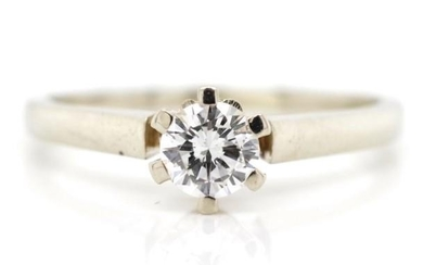 Diamond solitaire and 14ct white gold ring marked 585 WB. Ap...