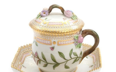 """Flora Danica"". A Royal Copenhagen pot de crème with cover and saucer, decorated in colours and gold with flowers. H. 9 cm."