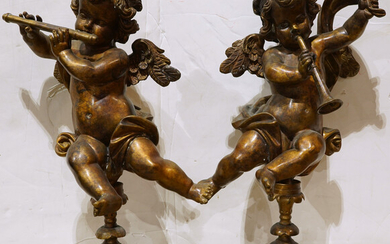 Pair of Rococo style gilt metal figural sculptures of putti