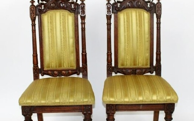 Pair of pierce carved oak side chairs