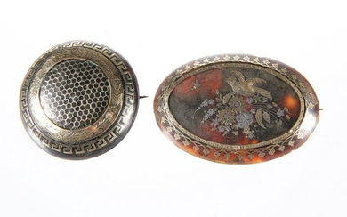 TWO 19TH CENTURY GOLD AND SILVER INLAID BROOCHES, the