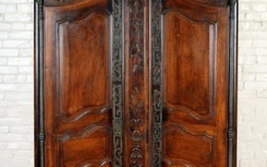 TWO DOOR FRENCH WALNUT ARMOIRE CIRCA 1800