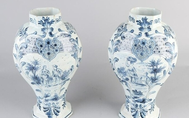 Two 19th century octagonal Delft Fayence vases. Figures