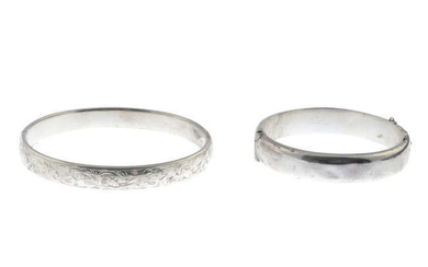 Two silver hinged bangles.
