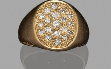 Yellow gold (18K) signet ring with an oval bezel paved with small brilliants.