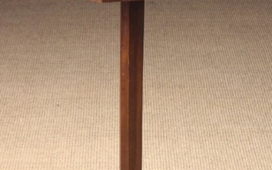 A 19th Century Cherrywood Candlestand. The octagonal top with applied edging strips, standing on an