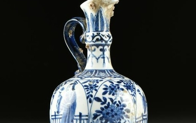 A CHINESE BLUE AND WHITE PORCELAIN EWER, SHIPWRECK