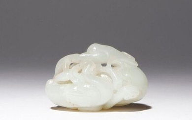 A CHINESE PALE CELADON JADE CARVING OF TWO GEESE 18TH...