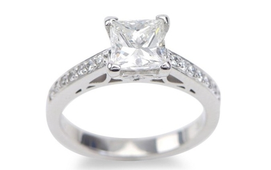 A DIAMOND RING - Featuring a princess cut diamond weighing 1.136cts, shouldered by round brilliant cut diamonds totalling 0.14cts, i...