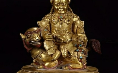 A GILT BRONZE FIGURE OF A CAISHEN