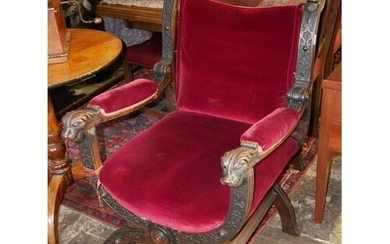 A LATE 19TH CENTURY CONTINENTAL OAK THRONE CHAIR Carved with...