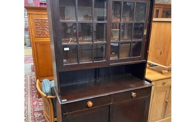 A Large Victorian glazed dresser. Sliding wood and glass doo...