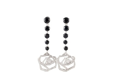 A PAIR OF DIAMOND EARRINGS BY CAVELLO, comprising a graduati...