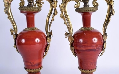 A PAIR OF MID 19TH CENTURY FRENCH TWIN HANDLED ORMOLU