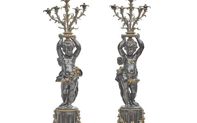 A Pair Of Monumental French Parcel Gilt and Patinated Bronze Figural Six Light Torcheres