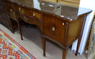 A Regency style mahogany serpentine-front sideboard, fitted ...