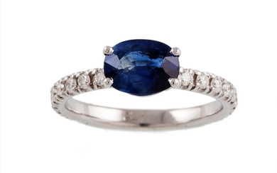A SAPPHIRE SINGLE STONE RING, the oval sapphire to diamond s...