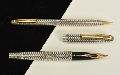 A SHEAFFER AND RETRACTABLE PENSIL SET, the fountain pen nib ...