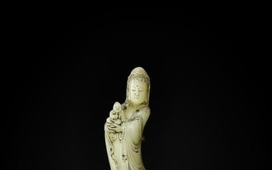 A SOAPSTONE FIGURE OF GUANYIN AND CHILD, QING